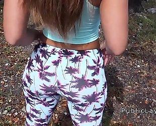 Latina hottie in legging shaking wazoo in public