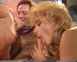 Jeanna Fine and Nina Hartley both sucking a guys cock