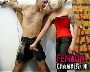 Female dominates her man with a strapon dildo