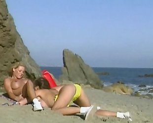 Sondra Hall and Jordan Haze lesbian sex on the beach.
