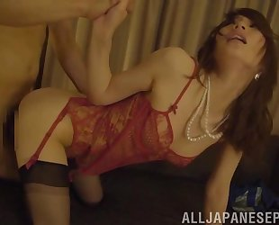 Asian MILF in black stockings enjoys passionate fucking