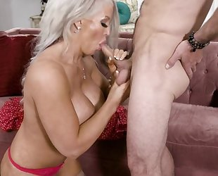Curvaceous stepmom with huge melons gets banged on the couch