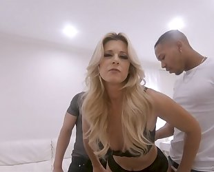 Pervy blonde MILF in stockings fucks two cocky studs in front of her cuckold hubby
