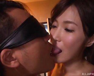 Asian minx rubs her pussy while sucking boyfriend's cock