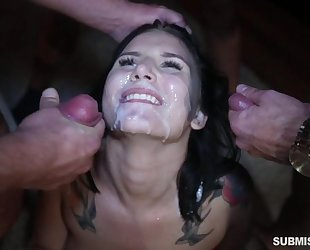 Blindfolded bitch servicing three stiff cocks at once