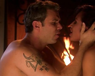 Dark-haired mature gets fucked by the fireplace