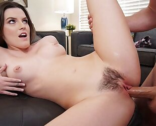 Dark-haired beauty pleasuring Sean in the living room