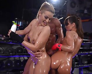 Two wild Serbian babes get oiled up and fucked hard in the gym