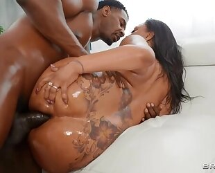 Bootylicious ebony with natural tits gets fucked in both holes